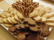 Peppermint Swirls, Gingerbread People, Macadamia Shortbread, Tomato Cheddar Palmiers